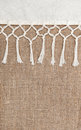Burlap background bordered by country cloth with fringe Stock Photography