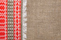 Burlap background bordered by country cloth red and green Royalty Free Stock Image
