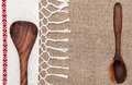 Burlap background bordered by country cloth and utensils with fringe Stock Photo