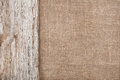 Burlap background bordered by old wood rude Royalty Free Stock Images