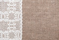 Burlap background with lacy cloth and white Stock Photos