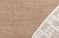 Burlap background with lacy cloth and white Stock Photography