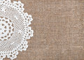 Burlap background with lacy cloth and white Stock Photo