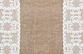 Burlap background with lacy cloth and white Stock Images