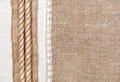 Burlap background with linen cloth and rope lace Royalty Free Stock Images