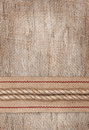 Burlap background with sacking ribbon and rope textile Stock Photography
