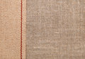 Burlap background with sacking ribbon textile Royalty Free Stock Photos