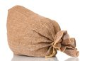 Burlap sack full small on white background Stock Photography
