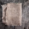 Burlap texture on wooden table background Royalty Free Stock Photo