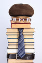 Burlesque image of the intellectual books eyeglasses a necktie Royalty Free Stock Images