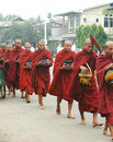 Burma Monks with alm bowls Royalty Free Stock Photography