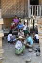 Burmese family at home a rests in the shade outside their in katha myanmar Stock Photography