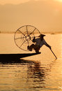 Burmese man catching fish on Inlay lake in Shan, Myanmar Royalty Free Stock Photo