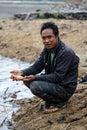 Burmese man holding freshwater fish Royalty Free Stock Photo