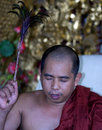 Burmese monk in a buddhist temple in penang Stock Images