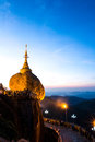 Burmese peaple pray kyaiktiyo pagoda in the morning golden rock pagoda kyaikto myanmar dec Royalty Free Stock Photo