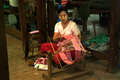 Burmese woman are spinning mandalay myanmar march senior while using spining cotton yarn apparatus in way of life on march in Stock Photos
