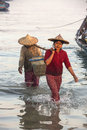 Burmese women bringing nights catch ashore dawn near fishing village ngapali beach myanmar burma Stock Images