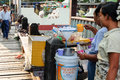 Burmese women are made by pouring cold water over the ice for sale Royalty Free Stock Photo