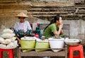 Burmese women selling street foods in Mandalay, Myanmar