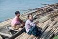 Burmese women traveling by boat