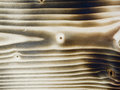 Burn of wood horizontal full format close up pine board burned on Royalty Free Stock Images