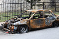 Burned car the rusty on a street Stock Photography