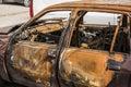 Burned car on the street Stock Photos