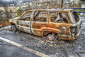 Burned Out Car Gutted By Forest Fire Royalty Free Stock Photo