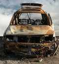 Burned out car photo illustration of a and rusted Royalty Free Stock Photography