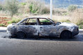 Burned out car in street Royalty Free Stock Photo