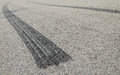 Burned rubber tire track asphalt road close up Stock Photo