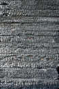 Burned wooden wall texture Stock Images