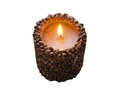 Burning aromatic coffee candle and coffee beans, isolated. Royalty Free Stock Photo