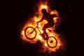 Burning bike bmx biker bikinig fire flames Royalty Free Stock Photo