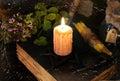 Burning candle on black magic book Royalty Free Stock Photo