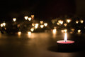 Burning candle with bokeh hearts Royalty Free Stock Photo
