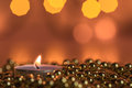 Burning candle and Christmas ornaments Royalty Free Stock Photo