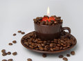 Burning candle and coffee beans Royalty Free Stock Photo
