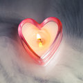 Burning candle heart in dense fog Royalty Free Stock Photos