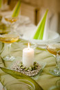 Burning candle in the middle of the wedding table Royalty Free Stock Images
