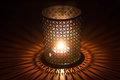 Burning candle in sconce on the table Royalty Free Stock Photo