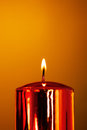 Burning candle wax on a yellow background Royalty Free Stock Photo
