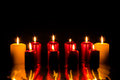 Burning candles and black background Royalty Free Stock Image
