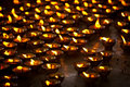 Burning candles in Buddhist temple Stock Photos