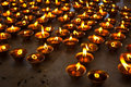 Burning candles in Buddhist temple Royalty Free Stock Photo