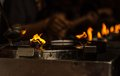 Burning candles at a Buddhist temple Royalty Free Stock Photo