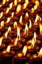 Burning candles in Buddhist temple. Dharamsala, Himachal Pradesh Royalty Free Stock Photo