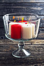 Burning candles in a glass vase on a wooden background Royalty Free Stock Photo