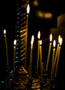 Burning candles on gold candlestick in the church isolated on black Royalty Free Stock Photo